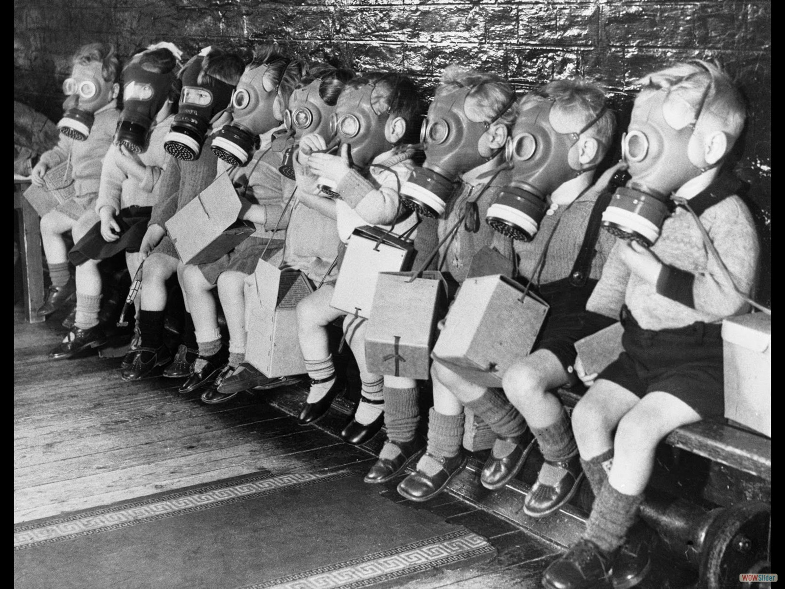 Children in gas mask practice
